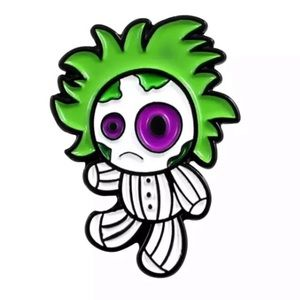 Jewelry - Beetlejuice doll green black and white pin NWT